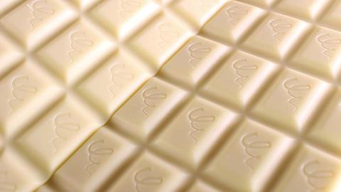 White chocolates chcolate bars bar food closeup texture pattern seamless looping Footage
