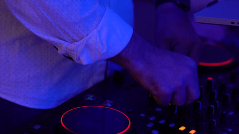 DJ works at a club party. Electronic music festival Footage