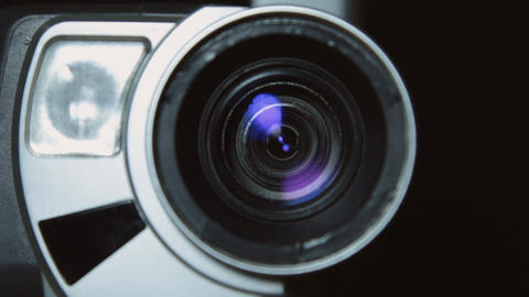 Camera zoom. Taking a close-up video cameras, increasing or decreasing scale Footage