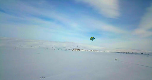 Aerial view of people snowkiting in tundra Footage