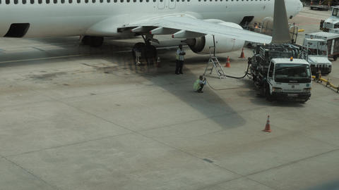 Unidentified Workers Of Airport working near airplane Footage