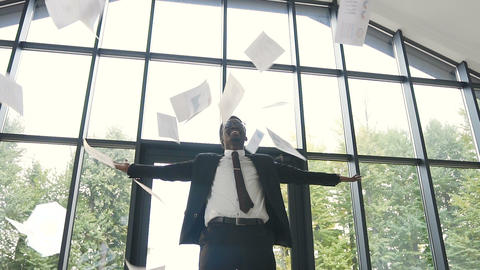 Successful and happy afro american businessman wearing in strict suit Live Action