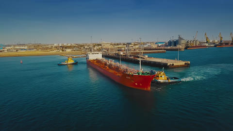 AKTAU, KAZAKHSTAN - OCTOBER 24, 2018: Towing an oil tanker from a pier to be ビデオ