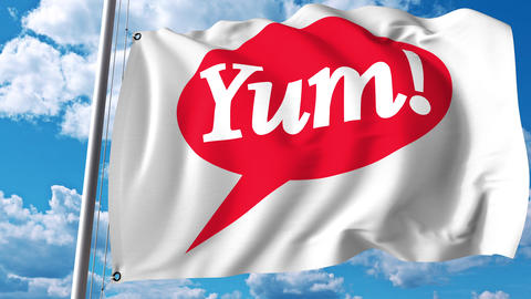 Waving flag with Yum Brands logo. 4K editorial animation Live Action