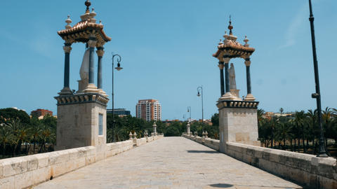 pov walking over the bridge of the Turia gardens in Valencia GIF