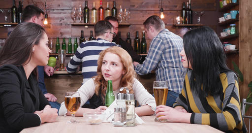 Female friends clinking their glasses with beer Footage