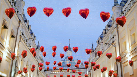 Red heart shape balloons waving in the wind GIF