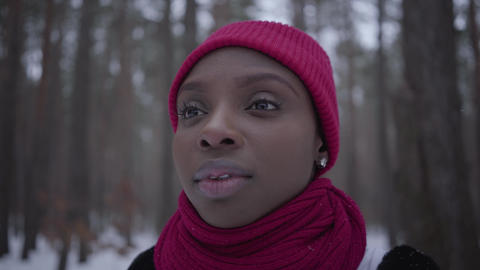 Portrait african american girl wearing a red hat and a red scarf standing in Footage