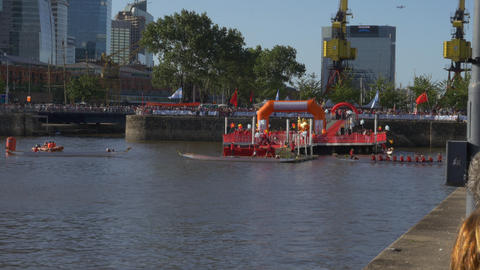Dragons boats being boarded at the Chinese new year celebration race Footage