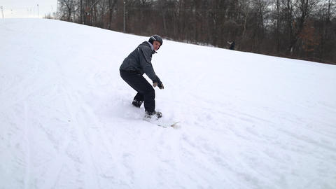 Action Shot of Snowboarder Skiing Down the Hill Footage