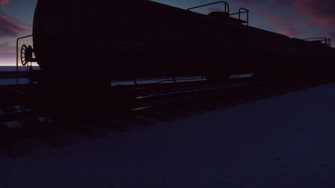 The camera flies past the railroad with cisterns passing through it with oil at GIF