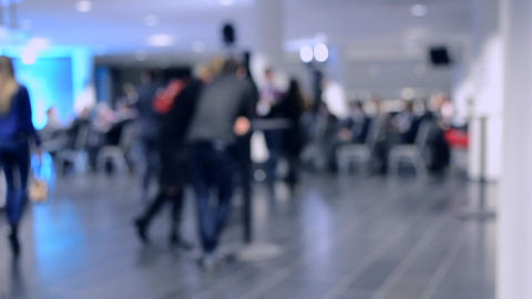 Blurred View of People. People in a large modern hall Footage