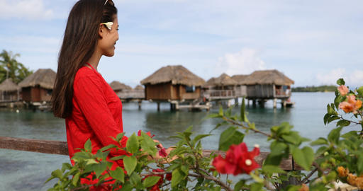 Travel Vacation luxury in French Polynesia Tahiti - woman by overwater bungalow Live Action