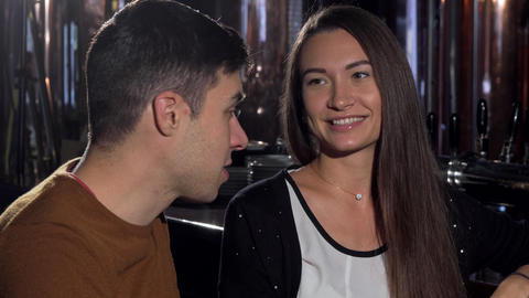 Young couple talking joyfully at the restaurant over cup of coffee Live Action