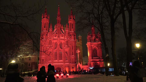 First Vilnius light festival, Church of St. Anne in red light and peoples at night, 2019 Footage
