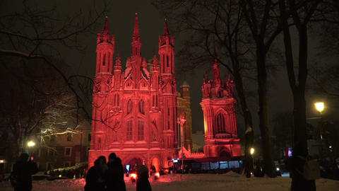 First Vilnius light festival, Church of St. Anne in red… Stock Video Footage