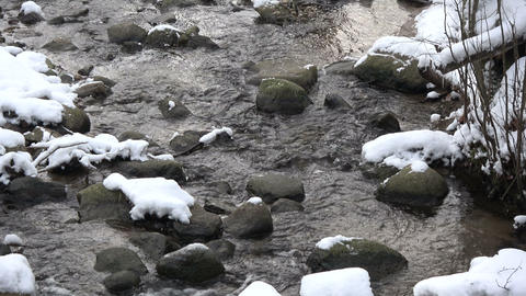 Winter stream river with stones and snow, winter landscape Live Action