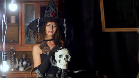 Halloween witch with a staff of a human skull Footage
