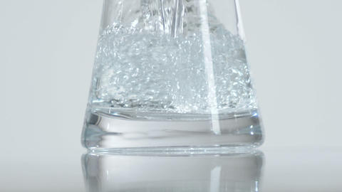 Close up of a glass container being filled with water Footage
