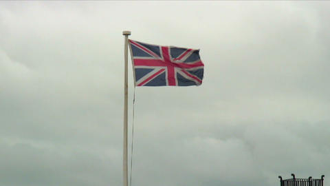 Flag of the United Kingdom waving atop a flagpole Live Action
