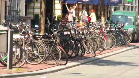 Bike rack full of bikes on a road median Live Action