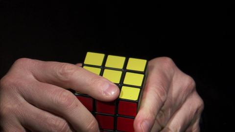 Rubik's Cube being solved on a black background Footage