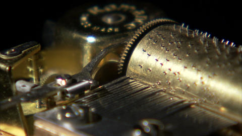 Close up of music box gears turning Live Action