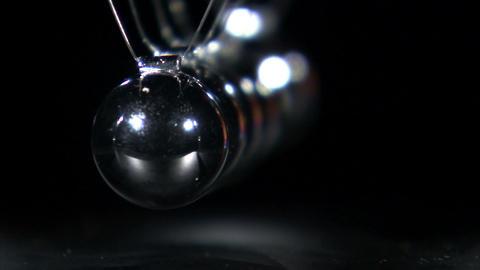 Rack focus of a Newton's Cradle in motion Footage