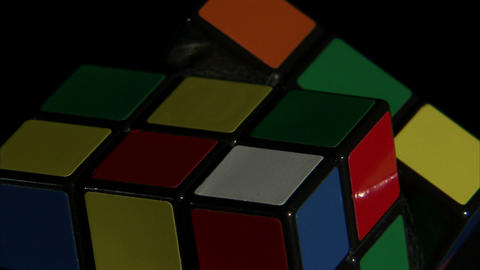 Close up of a Rubik's Cube spinning Live Action