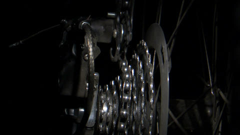 Bike chain shifting over rotating gears Footage