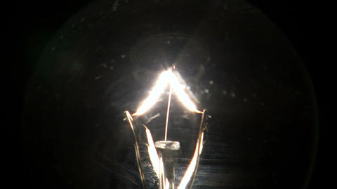 Close up of a light bulb fading on then off Footage