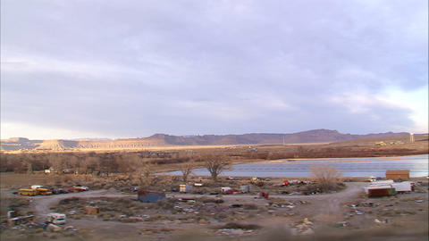 Junk yard in a desert seen from a moving car Live Action
