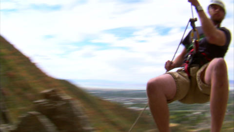 Shot of a mountain climber jumping over the camera Live Action