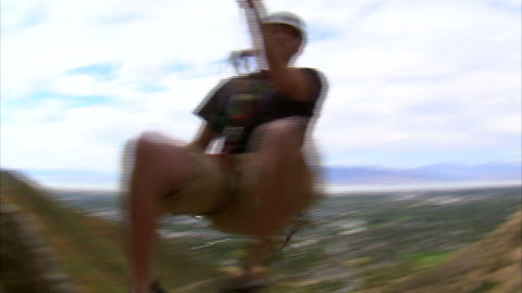 Rock climber jumping over the camera Live Action