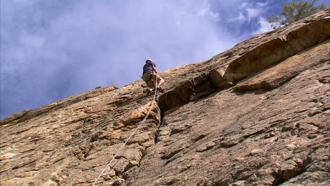 Mountain climber on a cliff face Footage