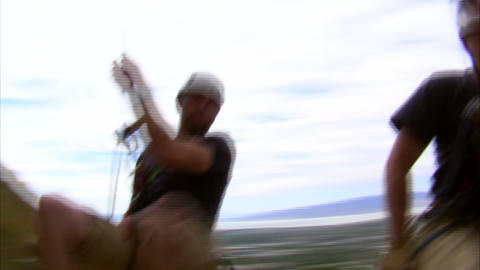 Clip of two rock climbers swinging over the camera Footage