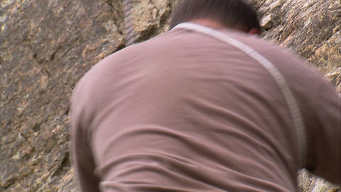 Rock climber climbing down a cliff Footage