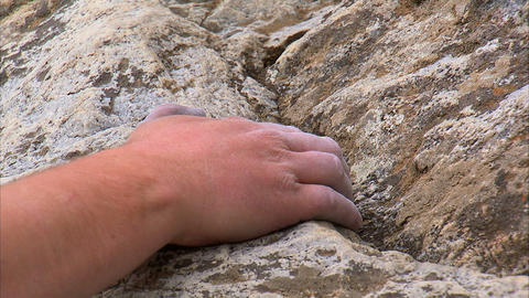Close up of a rock climber climbing a cliff Footage