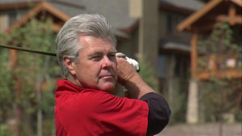 Close shot of a golfer swinging an iron Footage