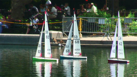 Remote control sailboats on a pond in Central Park New York City Footage