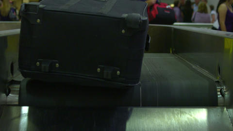 Luggage coming being dumped into baggage claim Footage
