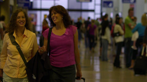 SALT LAKE CITY, UTAH - CIRCA 2012: People walk with their luggage at the airport Footage