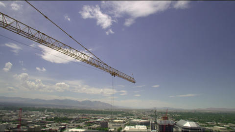 Tilt shot up to the sky, and then back down to the City Creek construction site Footage