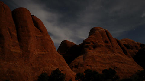 Time-lapse of stars and clouds over Moab, Utah rock formations Live Action