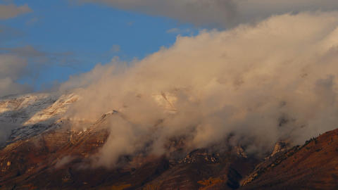 Time-lapse of clouds moving over the Wasatch Mountains in Utah Footage
