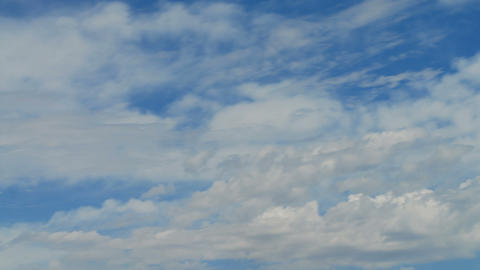 Time-lapse of thin clouds in the blue sky Footage