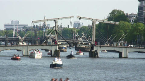 Time-lapse of boats going under bridges in Amsterdam Footage