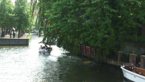 Boat going down a canal in Amsterdam Footage