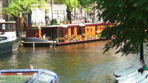 Ferry coming into view on a canal in Amsterdam Footage