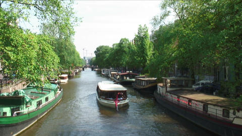 Boat traveling down a river in Amsterdam Footage